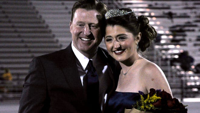 Claire Preston, here with her father Matt, was named Wylie High School homecoming queen Friday at Bulldog Stadium.