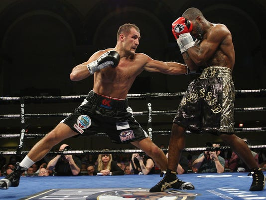 Sergey Kovalev, left, of Russia, punches Cedric Agnew, of the United States, during the sixth round of WBO light heavyweight boxing title in Atlantic City, N.J., on Saturday, March 29, 2014. Kovalev won by knockout in the seventh round. (AP Photo/Tim Larsen)