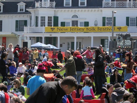 More than 15,000 from around the state come to the grounds of the Eagleton Institute on the Douglass Campus of Rutgers to take part in Rutgers Day and the Folk Festival.