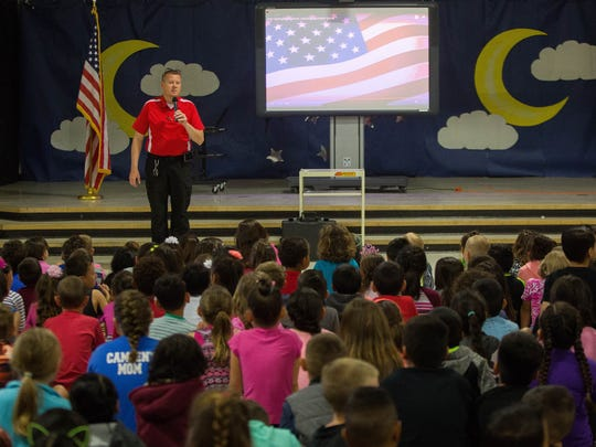 Chris Heisler, starts his presentation about the Honor Flag that since 9/11 has been used to pay tribute to the U.S. Military and the men and women in law enforcement. Heisler, brought the flag to Highland Elementary School one of the schools he was planning on visiting in Las Cruces, Friday, April 28, 2017.