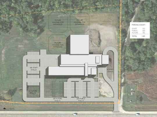 A drawing shows the proposed $22.9 million law enforcement center and jail in Dallas County, with room for expansion.