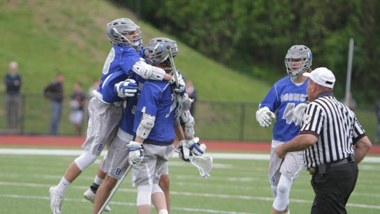 Bronxville celebrates after a goal from Brendon Krupa