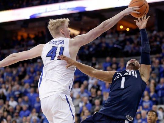 Creighton's Jacob Epperson (41) blocks a shot by Villanova's Jalen Brunson (1) during the second half of an NCAA college basketball game in Omaha, Neb., Saturday, Feb. 24, 2018. (AP Photo/Nati Harnik)