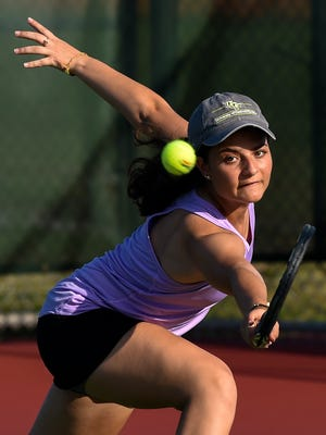 Fort Pierce Central senior Natalia Illuzzi stretches to return a serve from Treasure Coast Wednesday, Feb. 28, 2018, during their high school girls doubles tennis match at Whispering Pines Park in Port St. Lucie. To see more photos, go to TCPalm.com.