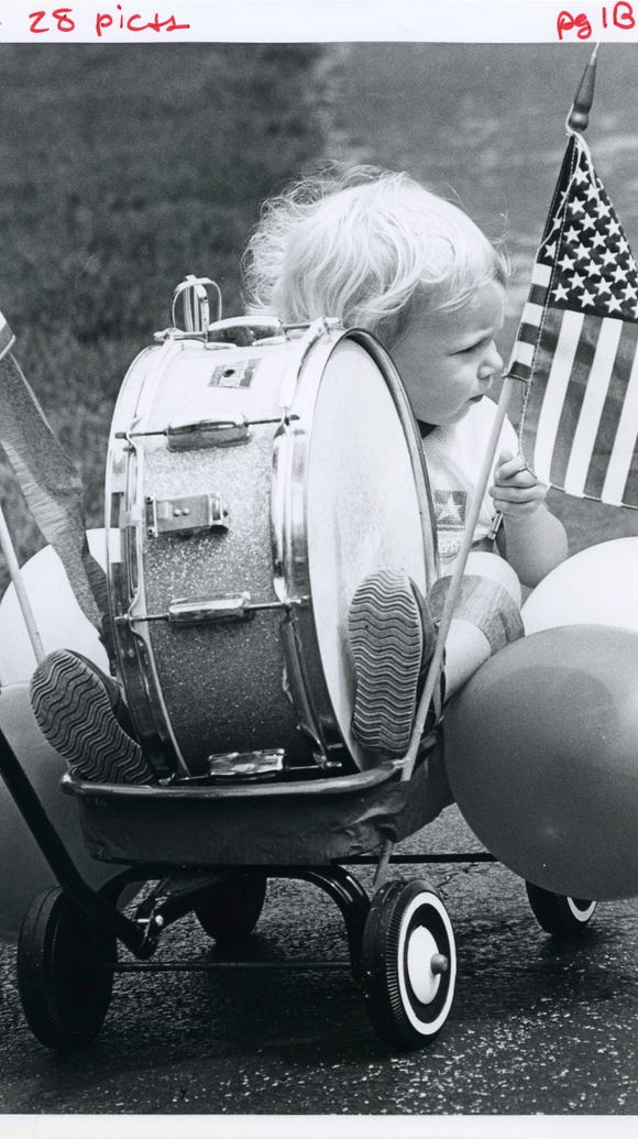 Two-year-old Clayton McGee rides in a wagon during