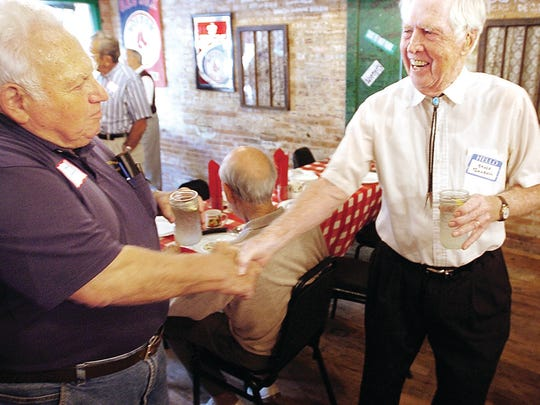 "Northville Township board member Marv Gans greets Northville's Bruce Turnbull during an ""Old Timers'"" luncheon at Genitti's. The first Monday of June each year, the Old Timers take over Genitti's to talk about days gone by and how much they've seen the city and township change."