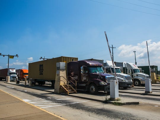 Trucks stop at gates at the CN Intermodal Gateway -