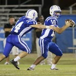 St. Frederick quarterback Barrett Coon hands the ball to running back Jack Henry Turner against Tensas.