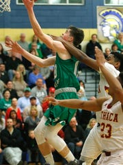 Leo Gallagher of Seton Catholic Central looks to score during the Southern Tier Athletic Conference boys basketball championship. Seton CC beat Ithaca, 64-49.