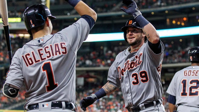 Tigers catcher Jarrod Saltalamacchia (39) celebrates with shortstop Jose Iglesias (1) after hitting a home run during the sixth inning Saturday in Houston.