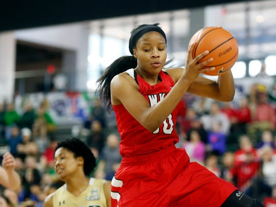 Western Kentucky forward Tashia Brown (10) grabs a rebound against UAB during the first half of an NCAA college basketball game in the Conference USA Women's Basketball Championship in Frisco, Texas, Saturday, March 10, 2018. (AP Photo/Michael Ainsworth)