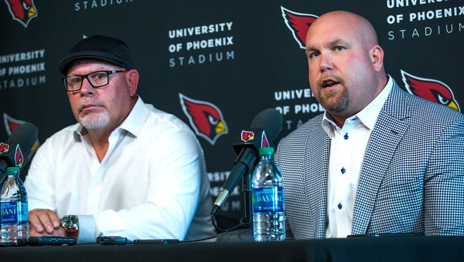 Arizona Cardinals head coach Bruce Arians, left,  and General Manager Steve Keim talk about the upcoming NFL draft during a press conference at the Tempe training facility , Tuesday, April 19, 2016.