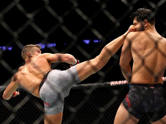 Stephen Thompson lands a kick against Jorge Masvidal in their welterweight bout during the UFC 217 event at Madison Square Garden on Nov. 4, 2017.