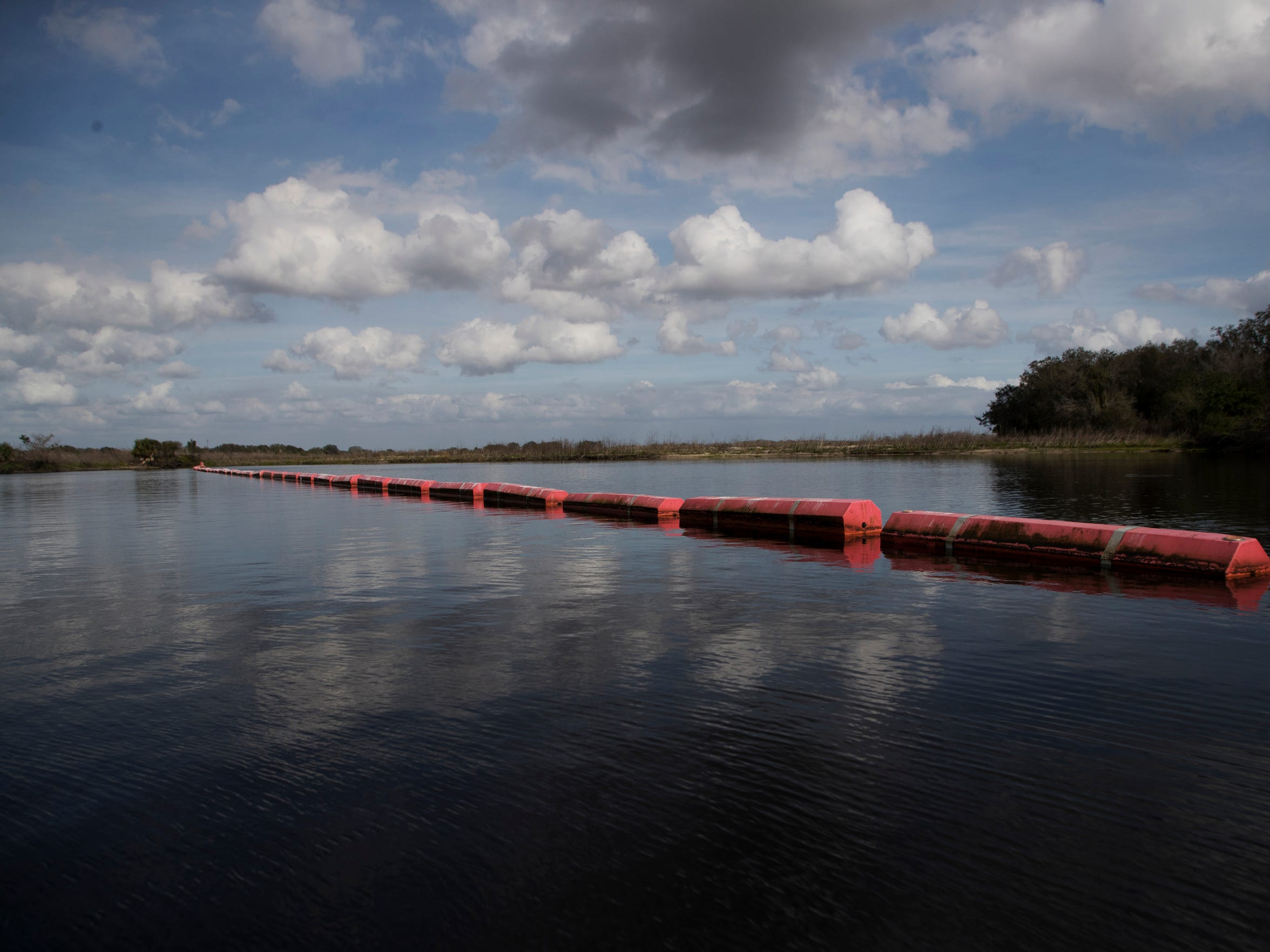 Barriers on the Kissimee River in the restored area keep boaters out of construction zones.