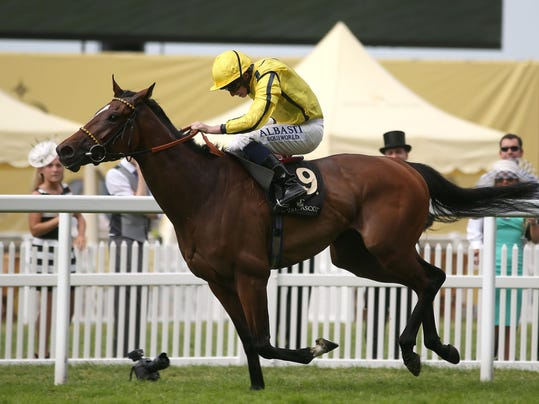 Rizeena ridden by Ryan Moore wins the Coronation Stakes during day four of the 2014 Royal Ascot Meeting at Ascot Racecourse, southern England, Friday June 20, 2014. (AP Photo/PA, Steve Parsons)  UNITED KINGDOM OUT  NO SALES  NO ARCHIVE