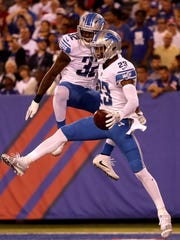 Lions DBs Darius Slay, right, and Tavon Wilson celebrate in the first quarter against the Giants on Sept.18, 2017 at MetLife Stadium.