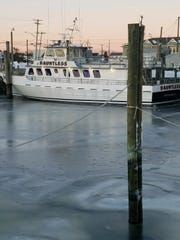 Ice has formed around the fishing boats on Cooks Creek