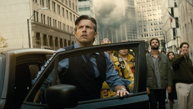 "Bruce Wayne (Ben Affleck) watches as the city crumbles in ""Batman v Superman: Dawn of Justice."""