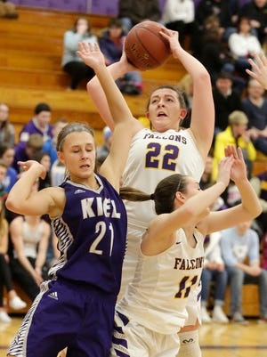Sheboygan Falls' Allison Antonie (22) aims for the basket by Kiel's Lilliana Schmitz (21), Friday February 9, 2018 in Sheboygan Falls, Wis.