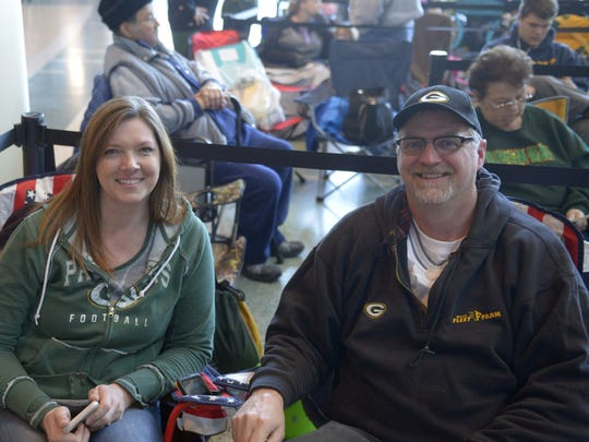 Sheila Stelzl, left, and Mark Stelzl were first in line Monday, Dec. 12, 2016, to get Aaron Rodgers' autograph at the Lambeau Field Atrium in Green Bay. Rodgers signed 200 autographs for a minimum donation of $100 each to raise money for The Salvation Army of Greater Green Bay on Monday night.