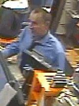 Authorities released this security tape photo of a bank robbery suspect in Neola, Ia.