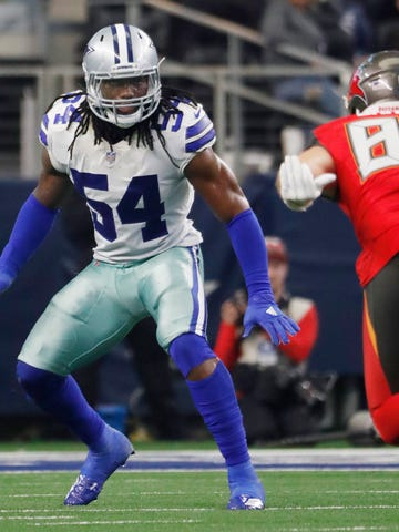 FILE - In this Sunday, Dec. 23, 2018 file photo, Dallas Cowboys linebacker Jaylon Smith against the Tampa Bay Buccaneers during an NFL game in Arlington, Texas. The Dallas Cowboys have given young linebacker Jaylon Smith a new contract while the holdout by Pro Bowl running back Ezekiel Elliott nears a month since the team reported to training camp. Smith's extension was announced Tuesday, Aug. 20, 2019. (AP Photo/Andy Jacobsohn, File)