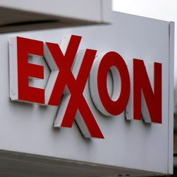 This April 29, 2014 photo shows an Exxon sign at a Exxon gas station in Carnegie, Pa.