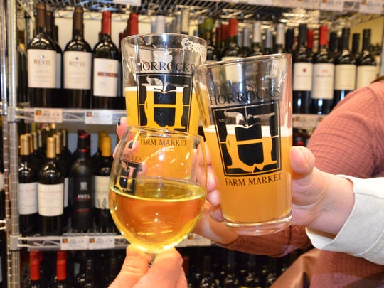 Cheers from the bar area inside Horrocks Farm Market, located at 235 Capital Avenue SW, in downtown Battle Creek.