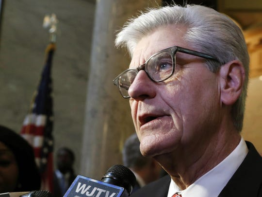 In this Jan. 30, 2019, file photo, Gov. Phil Bryant speaks to reporters at the Capitol in Jackson, Miss. A Michigan man has been arrested on charges that he made death threats to Bryant in January.