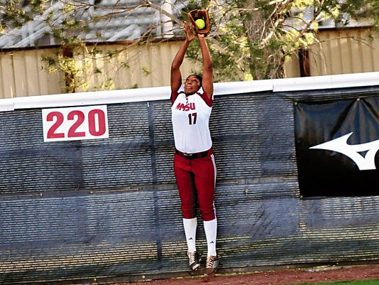 Jaime Guzman/For the Sun-News   New Mexico State outfielder Staci Rodriguez robs a Missouri-Kansas City hitter of a possible home run during Friday night's game at the NMSU Softball Complex.