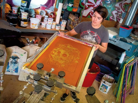 Jett Loe--Sun-News   Artist Steph Preciado-Shelton works in her screen printing shop Reviver. Reviver does a variety of printing with a focus on T-shirts and posters.