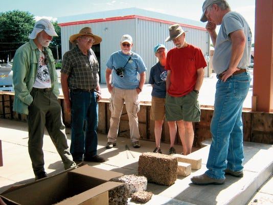 Gordon West, right, discusses some alternative building materials at a workshop to build a chipcrete wall to define the parklet at the Office of Sustainability, located at 1106 N. Pope St. The workshop continues at 9 a.m. on Saturday. Courtesy Photo