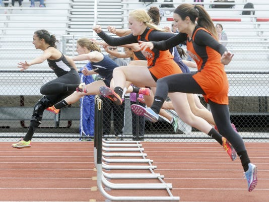 Dallastown's Taylor Forrester, second from left, finished second in the 100-meter hurdles at the White Rose Invitational at Central York High School last season.