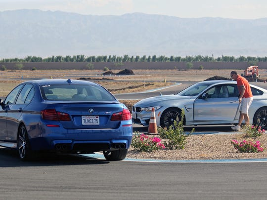 During a two-hour session, participants test drive and rotate through four BMW cars, Tuesday, July 7, 2015, at the BMW Performance Center in Thermal. The models included a M4, M5, X5 and X6.