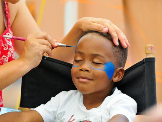 4 year old Kyan Edmonds gets his face painted during