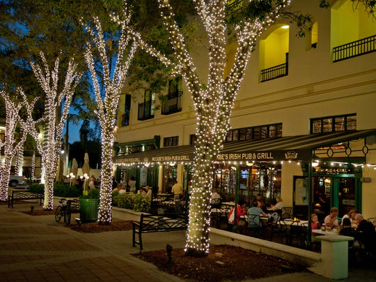 Lights shine bright along Fifth Avenue South, downtown Naples, Florida.
