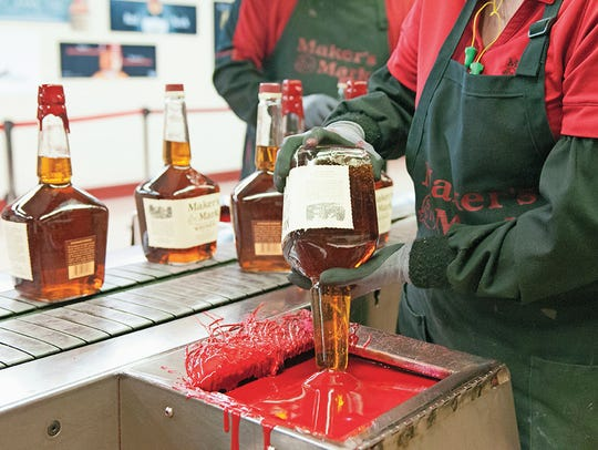 The Maker's Mark wax dipping process.