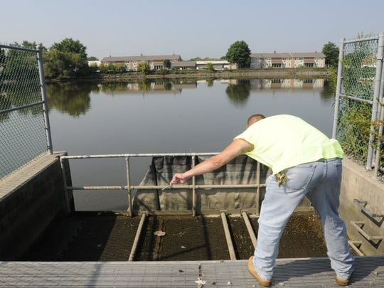 A DPW worker at a netting chamber along the Hackensack River in Ridgefield Park. The chamber is used to catch sewage overflows into the waterway; it's one of six such chambers in Ridgefield Park.
