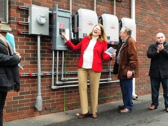 Pastor Susan Dorward, center, turns on Brookdale Reformed Church's solar electrical system in January 2016. Joining her, from left, are Church Conservatory Vice President Jean Brown, Property Chairman Jim Thompson and Bloomfield Mayor Michael Venezia.