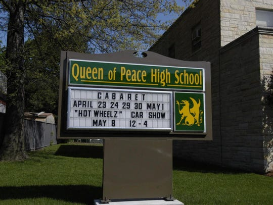 Queen of Peace High School sign in this 2004 photo.