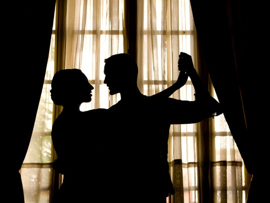 Silhouette of couple dancing.