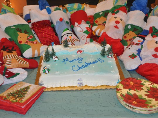 Pelican Garden residents received Christmas stockings and a cake almost too beautiful to cut from the EL-DOEs of Sebastian Elks Lodge 2714.
