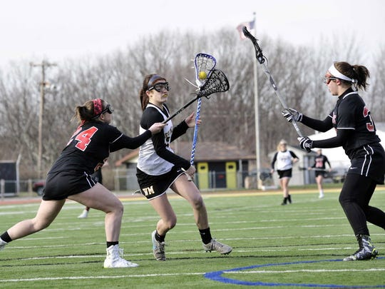 Taylor Bishop, center, is one of nine seniors on the West Milford girls' lacrosse team roster this spring. Bishop, who is committed to Mercy College, led the Highlanders in scoring in 2017.