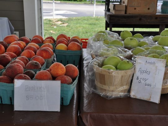 A seasonal farmers market at the New Stanton service plaza offers fresh peaches, baked goods and jam.
