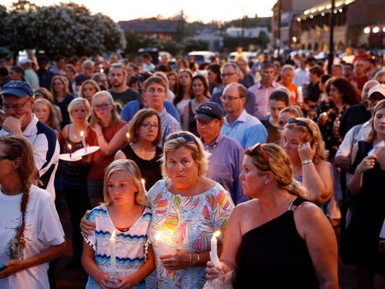 Mourners stand in silence during a vigil in response to a shooting at the Capital Gazette newsroom, June 29,  2018, in Annapolis Maryland.