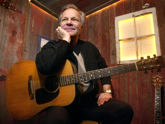 Bobby Vee poses with a guitar in April 2004 at Rockhouse