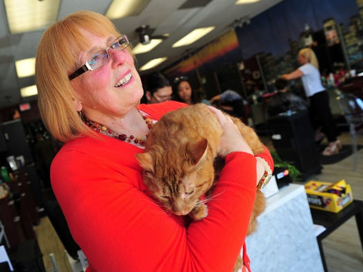 Diane Somma of Budd Lake with Jeremiah, a 3-year-old friendly orange cat.