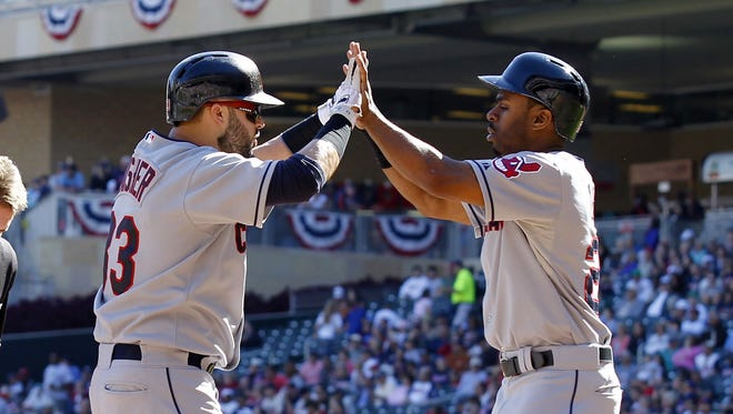 Nick Swisher celebrates his two-run homer with Michael Bourn.