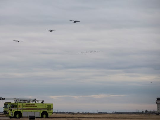 Three Coast Guard HC-144 fly over the Corpus Christi International Airport as they prepare to land Wednesday, Jan. 17, 2018.