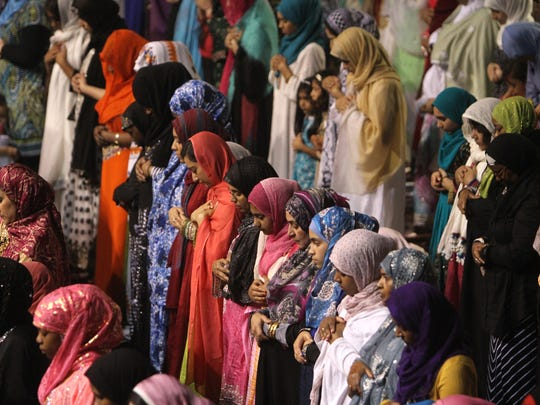 People celebrate the end of Ramadan with a prayer service Monday at the at the Henrietta Dome Arena.